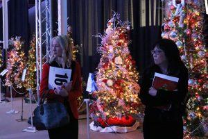 Kimberly Arnoldus, left, an Arlene Fukai look at the Christmas trees on display at the Magic of the Lights Gala event at the Santa Clarita Sports Complex on Saturday. Nikolas Samuels/The Signal