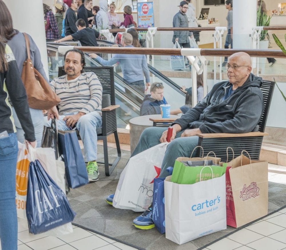 Arturo Lopez of Santa Clarita (L) and Roy Morse of Castaic (R) wait for their wives to complete their shopping at the Westfield Valencia Town Center on Black Friday. Photo Tom Cruze/For the Signal