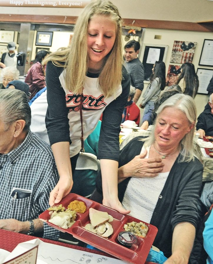 Hart High School student Aspen Sorenson serves seniors at the Santa Clarita Valley Senior Center during 35th Thanksgiving feast hosted by the Castaic Lions Club, the William S. Hart Union High School District and the SCV Senior Center in Newhall on Thursday. Dan Watson/the Signal