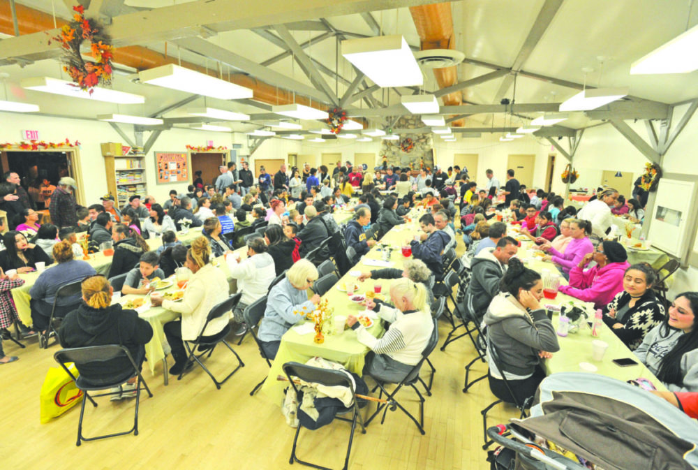 Real Life Church volunteers serve Thanksgiving dinner to members of the Val Verde community at the Val Verde Recreation Center.  Dan Watson/The Signal