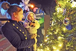 Crystal Lynn, left, and son Leo, 2, get a close up look at the 20 foot Christmas tree at the amphitheater at the Valencia Marketplace Community Tree Lighting in 2015. (Dan Watson / The Signal)
