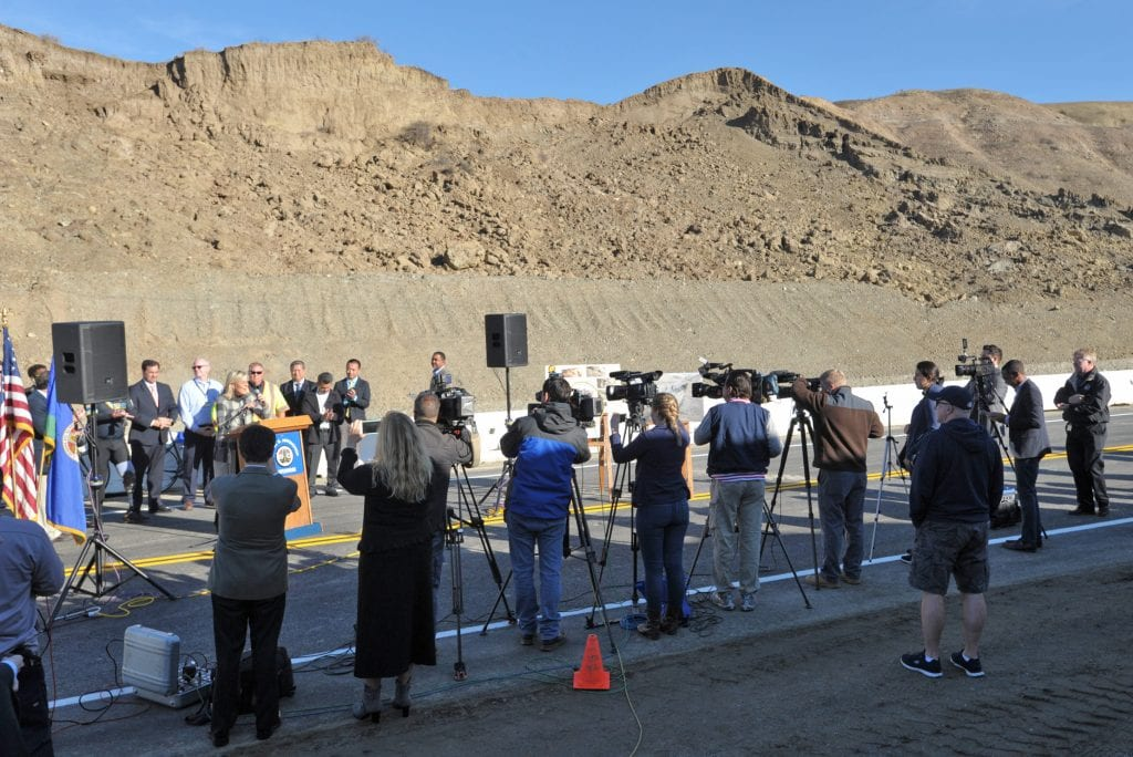 Media lines up to record the official re-opening of Vasquez Canyon Road on Wednesday morning. Dan Watson/The Signal