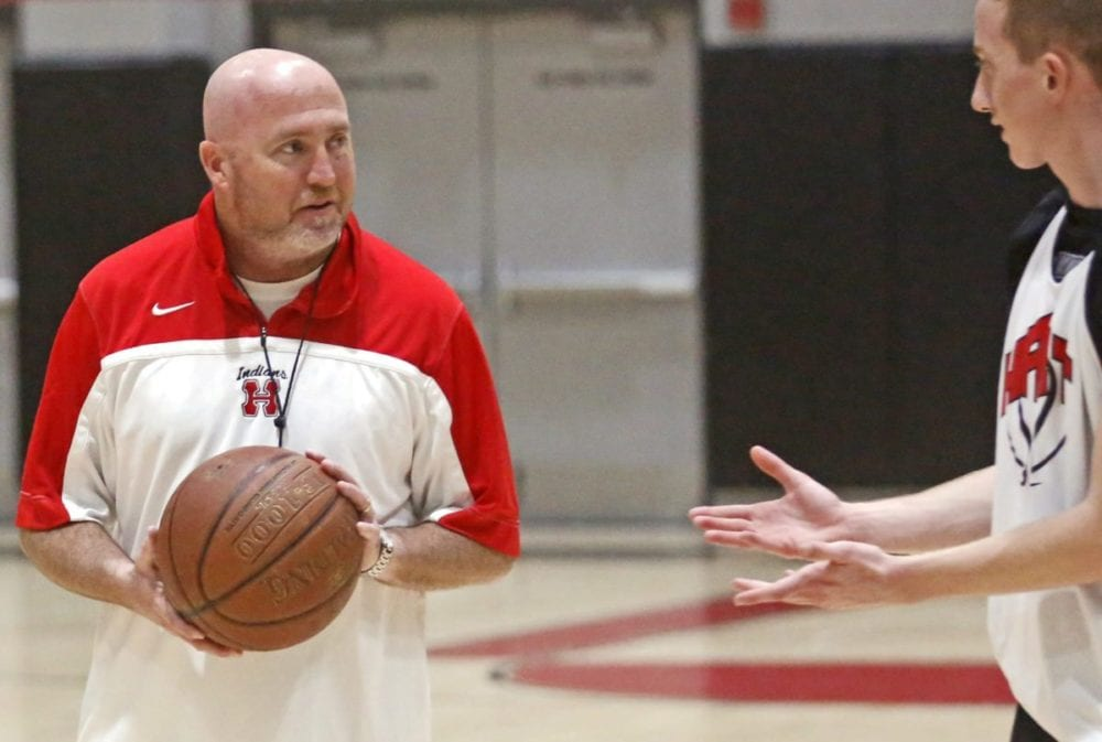 Hart varisty boys basketball coach Tom Kelly, left, talks with a player before starting a drill at practice on Tuesday. Katharine Lotze/Signal