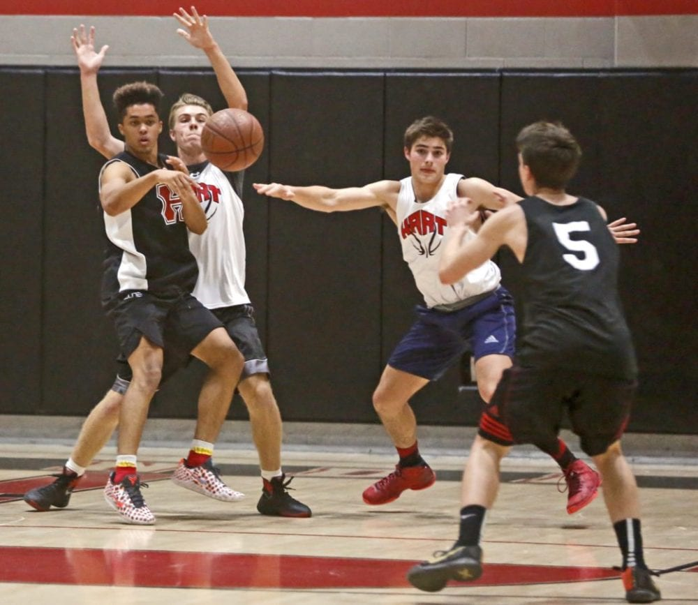 The varsity boys basketball team at Hart scrimmages during a practice on Tuesday. Katharine Lotze/Signal