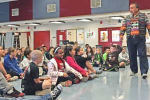 Northlake Hills Elementary School students in Kacy Duncan's, Meg Waymire's and Beth Chamberlin's fourth grade classes participate in an interactive musical performance led by Native American musician Martin Espino as part of the school's first Native American Day. Christina Cox/The Signal