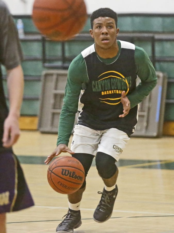 Canyon's Brandon Wilson looks for an opening to the basket during a drill at boys varsity basketball practice at Canyon on Monday. Katharine Lotze/Signal