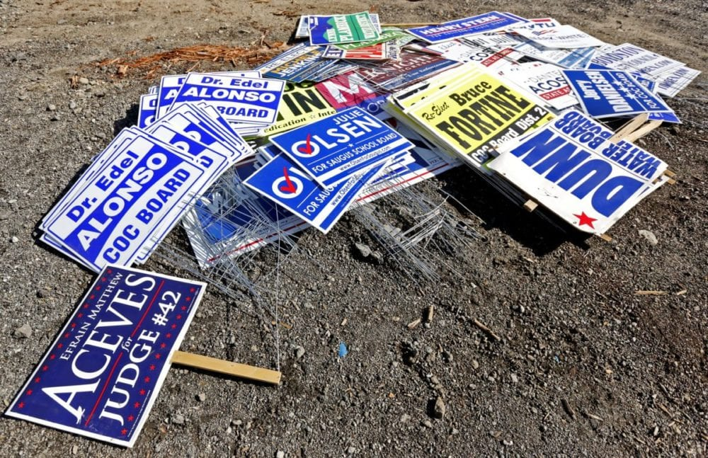 Campaign signs are piled up in a City of Santa Clarita storage yard off of Bouquet Canyon on Monday. The city collected about 300 campaign signs following the 2016 general election. Katharine Lotze/Signal