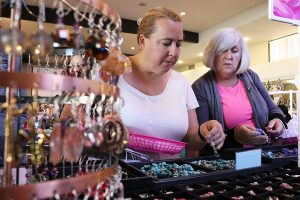 Nicola Foley, left, and Alison Denney browse through home-made jewelry at the eighth annual American Cancer Society 2016 Annual Relay for Life Holiday Boutique at Santa Clarita United Methodist Church on Saturday. Nikolas Samuels/The Signal