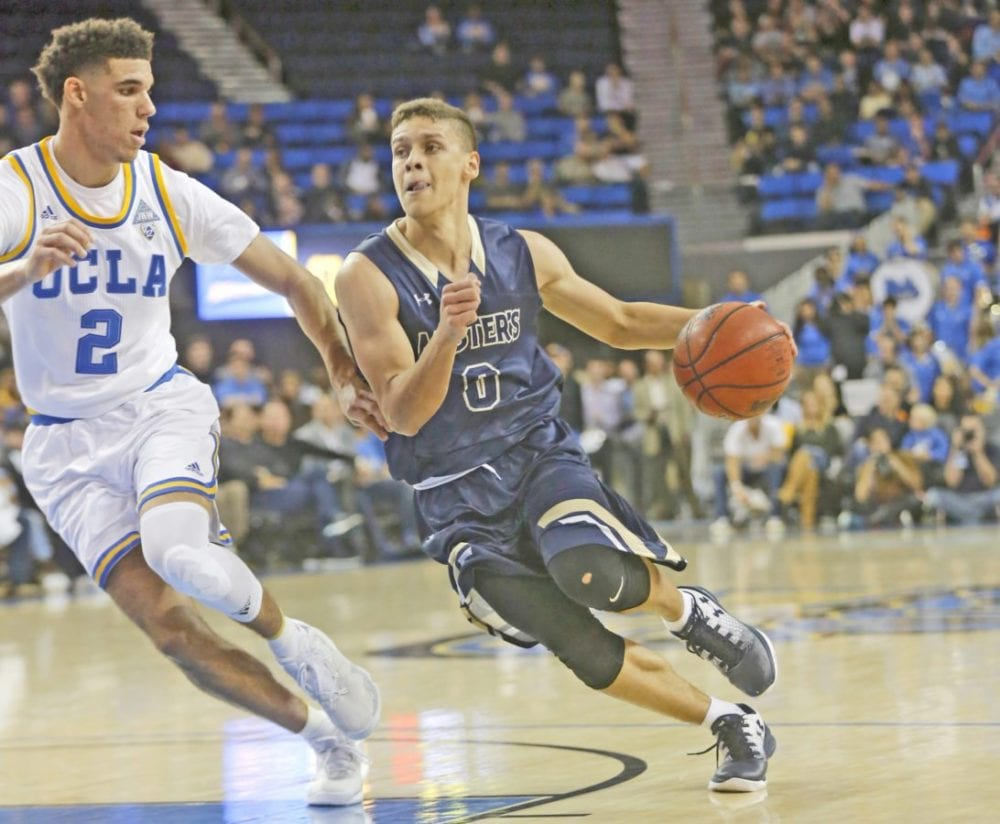 The Master's University's Hansel Atencia (0) drives toward the basket as UCLA's Lonzo Ball (2) keeps up during an exhibition game at Pauley Pavilion in Los Angeles on Nov. 1. Katharine Lotze/Signal