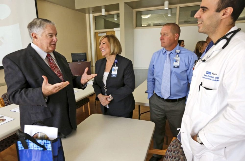 College of the Canyons womens basketball coach Greg Herrick, left, talks with Henry Mayo Hospital's Jean Marie Stewart, center, Dustin Ashenfelter, right, and Dr. Behi Rabbani, far right, on Tuesday about the day in September first responders, nurses, and doctors helped save Herrick from a heart attack. Katharine Lotze/Signal