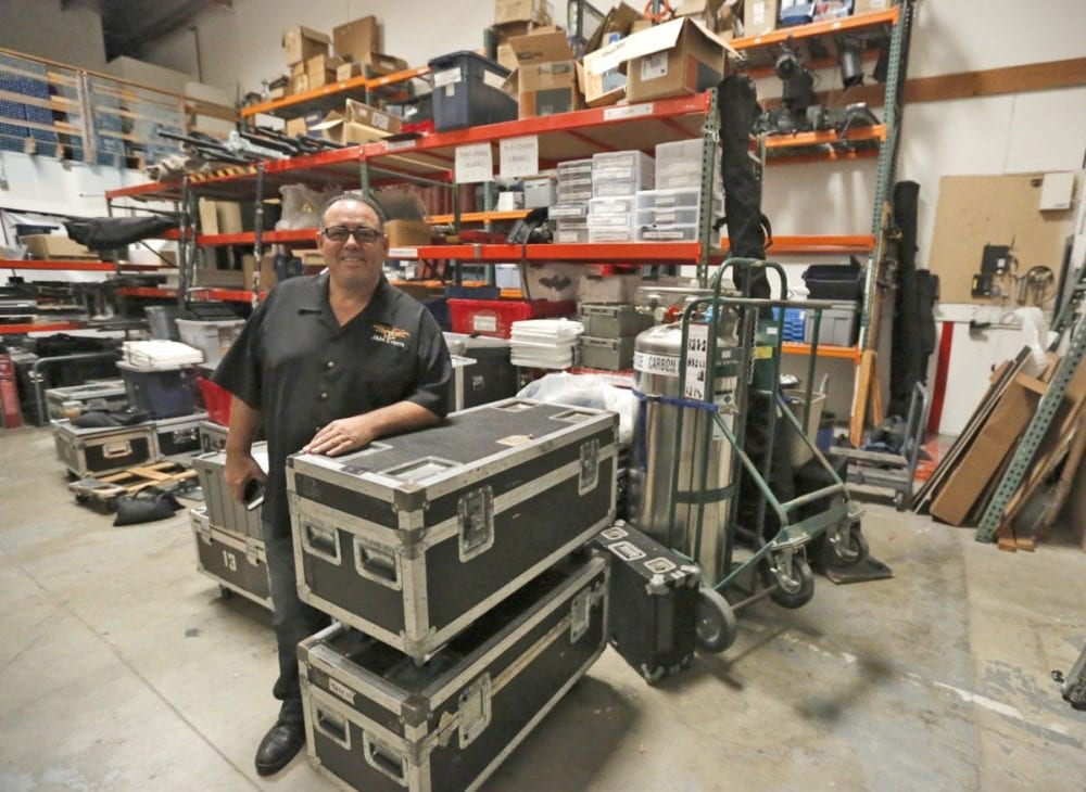 Jorge Lopez, owner, president and CEO of J&M Entertainment, stands in the company's Valencia warehouse on Oct. 3. Katharine Lotze/Signal