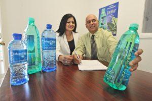 Mala Sharma, left, Pramesh Sharma at the  Island Blu Water office in Valencia. 101316  Dan Watson/The Signal