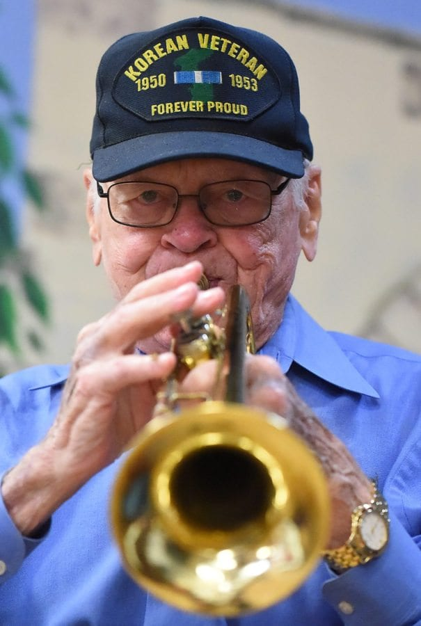 Korean War Veteran Bob Danis on the trumpet for the playing of the Marines' Hymn at Friday's event at the SCV Senior Center. Jayne Kamin-Oncea/For The Signal