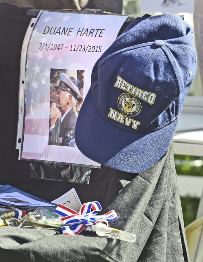 A chair draped in black is reserved for Navy veteran Duane Harte who died last year on November 23rd 2015. Harte was the Master of Ceremonies at the annual Veterans Day Ceremonies and was missed at the 2016 event held at Veteran's Historical Park in Newhall on Friday. Dan Watson/The Signal