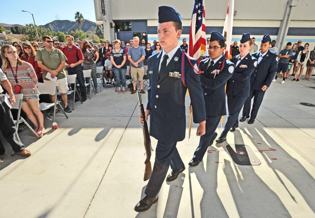 Hart District Junior ROTC Color Guard marches in front of the hundreds in attendance for the unveiling of the Wall of Honor at Saugus High School on Friday. Dan Watson/The Signal