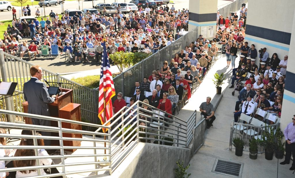 Saugus High School principal Bill Bolde, left, speaks to the hundreds in attendance for the unveiling of the Wall of Honor at Saugus High School on Friday. Dan Watson/The Signal
