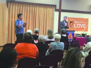 Rev. Peter Fariday and Music Director Scoot Roewe lead the UU of SCV congregation in a prayer of gratefulness during Sunday service. The final Religious Exploration discussion session will be held at the Valencia Hills Clubhouse Nov 17 at 7 p.m.