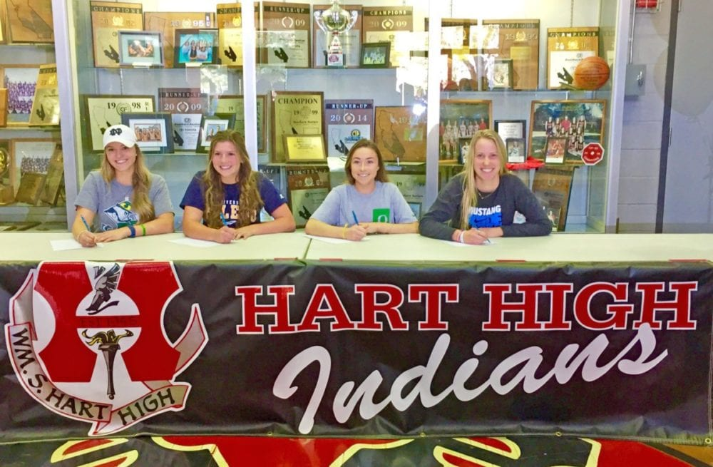 Hart High signees (left to right) Abby Sweet (Notre Dame University, softball), Kylie Norwood (University of Toledo, softball), Claire Vogelsang (University of Oregon, acrobatics and tumbling) and Madi Fay (The Master's University, women's volleyball). Courtesy photo