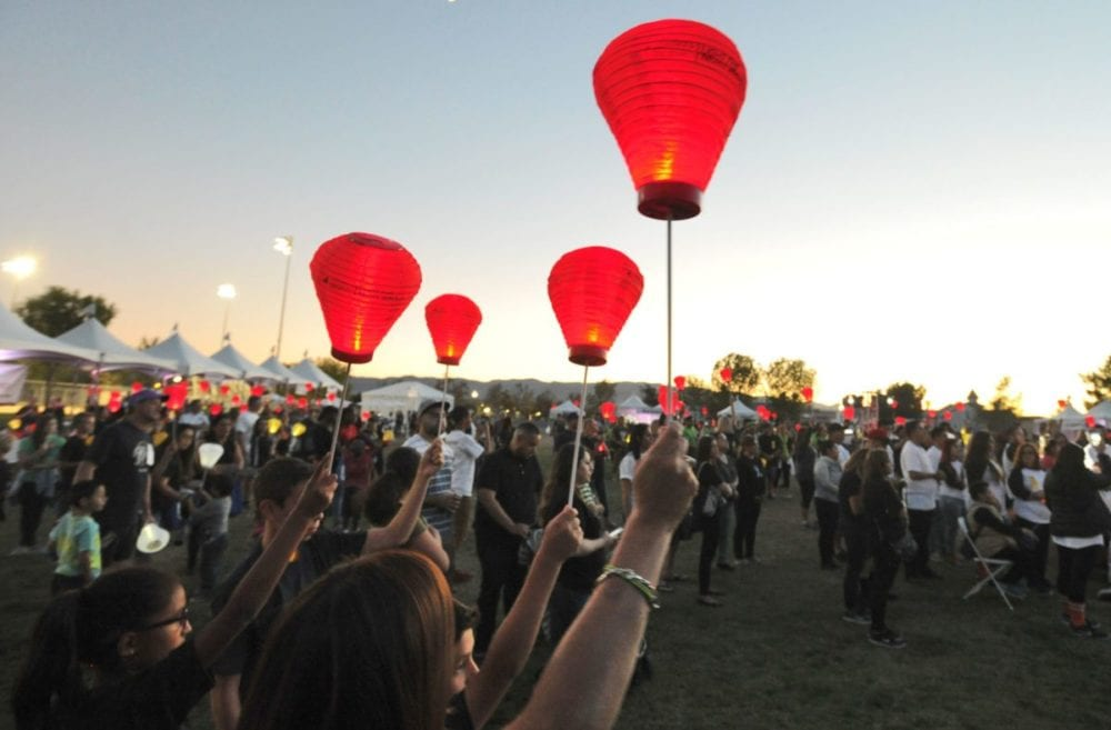 Hundreds of attendees hold up their red lanterns to show their support for the Leukemia & Lymphoma Society at the annual Light the Night Walk held at Bridgeport Park in Valencia on Saturday. Dan Watson/The Signal