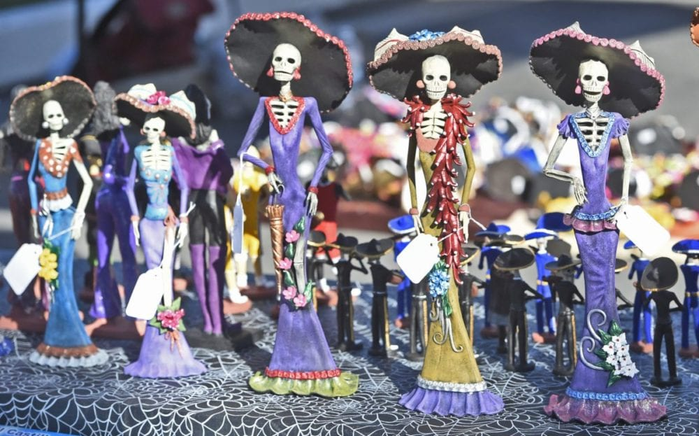 Hand-made figurines of La Catrina, the symbol of Dia de los Muertos available festival available at Eternal Valley Memorial Park in Newhall on Saturday. Dan Watson/The Signal
