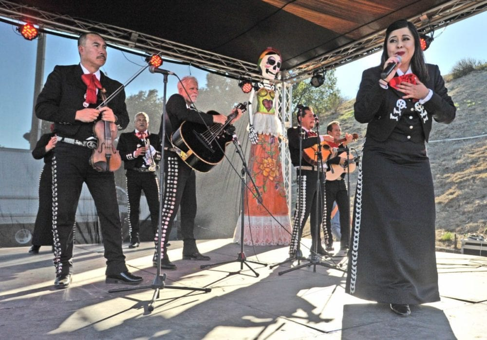 Mariachi Fuertes entertains on stage at the annual Dia de los Muertos festival held at Eternal Valley Memorial Park in Newhall on Saturday. Dan Watson/The Signal