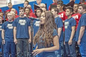 Photo Tom Cruze/For the Signal Kayla Calove, a senior at Saugus High School, sings a solo during the final song as the Saugus High School Concert Choir joins The Gay Men's Chorus of Los Angeles during a performance at Saugus High School.