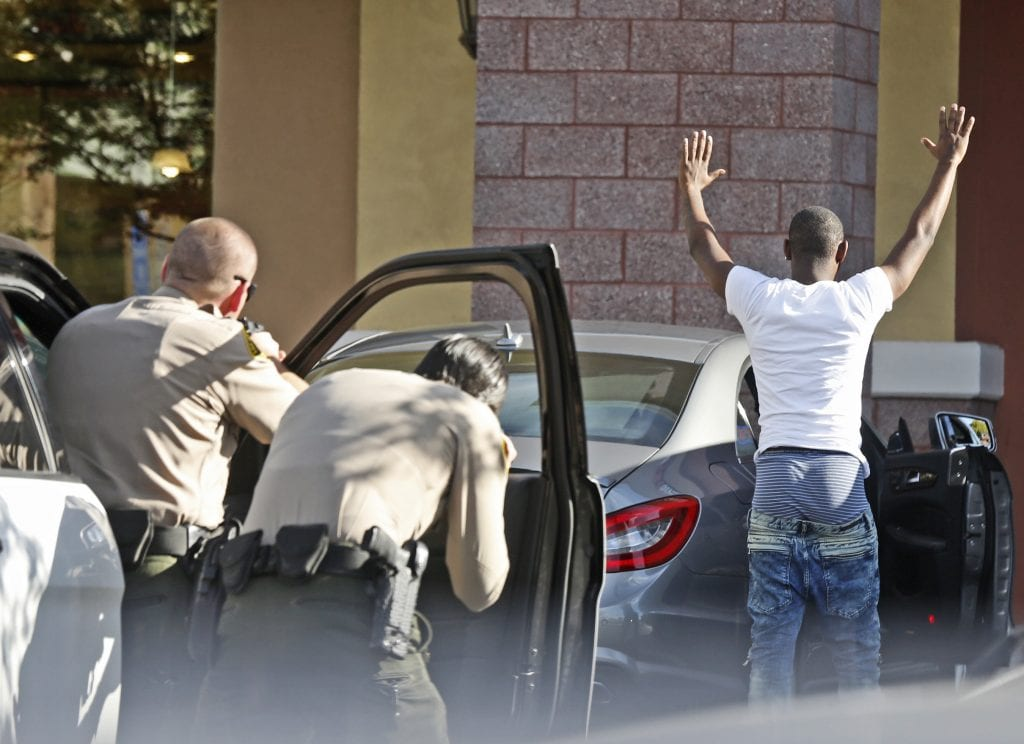Santa Clarita Valley Sheriff's deputies hold the occupant of a car at gunpoint as they instruct him to exit the vehicle in front of GameStop on Friday. Katharine Lotze/Signal