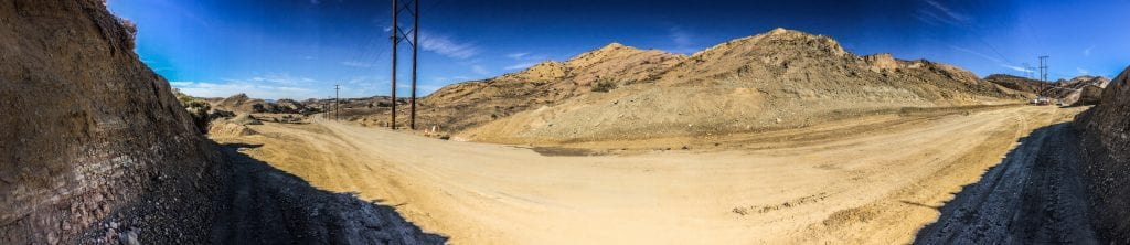 In this panarama, work progresses on Vasquez Canyon Road Friday afternoon. County Public Works officials said the road could open in two weeks. Austin Dave/The Signal