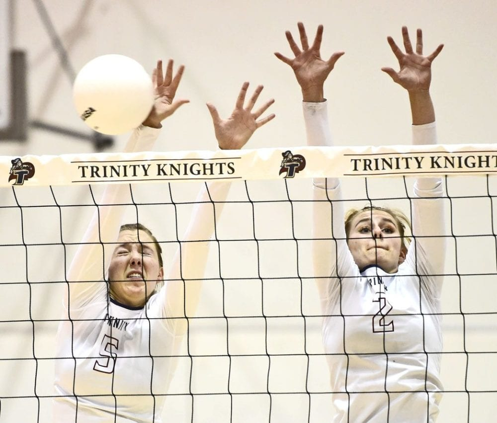 Trinity Classical Academy defenders Emily Buchanan (5) and Carissa Bixler (2) go up to block a shot by Mammoth on Thursday. Dan Watson/The Signal