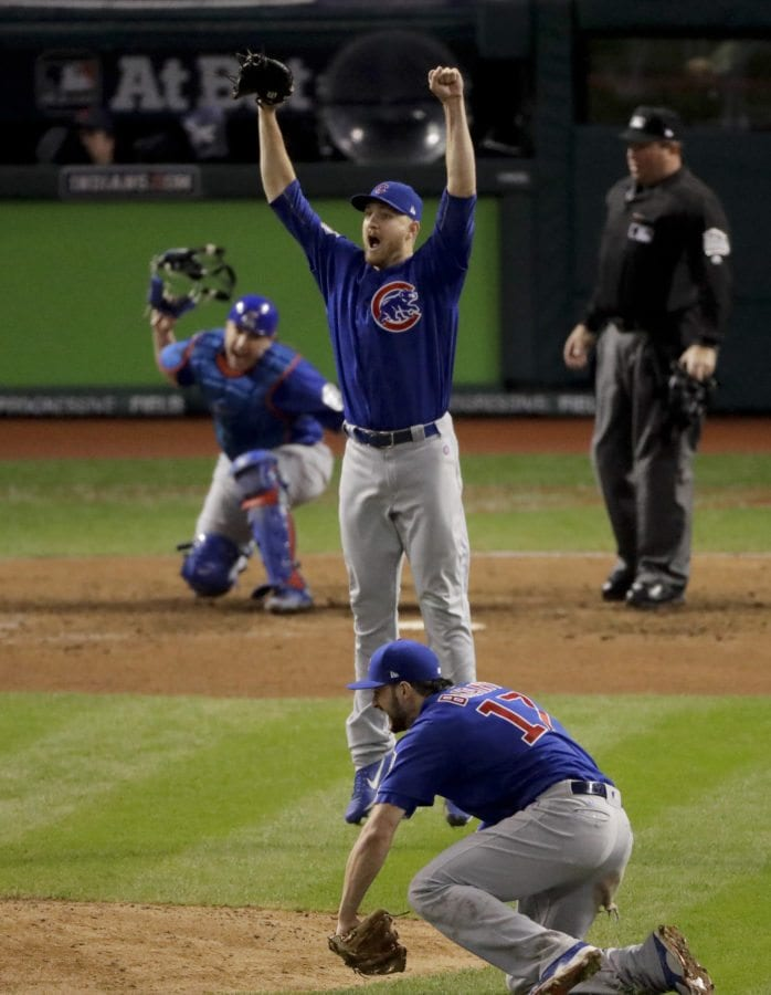 Chicago Cubs relief pitcher Mike Montgomery celebrates after after Game 7 of the Major League Baseball World Series Thursday, Nov. 3, 2016, in Cleveland. (AP Photo)