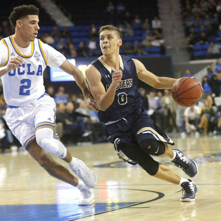 The Master's University's Hansel Atencia (0) drives toward the basket as UCLA's Lonzo Ball (2) keeps up during an exhibition game at Pauley Pavilion in Los Angeles on Tuesday. Katharine Lotze/Signal