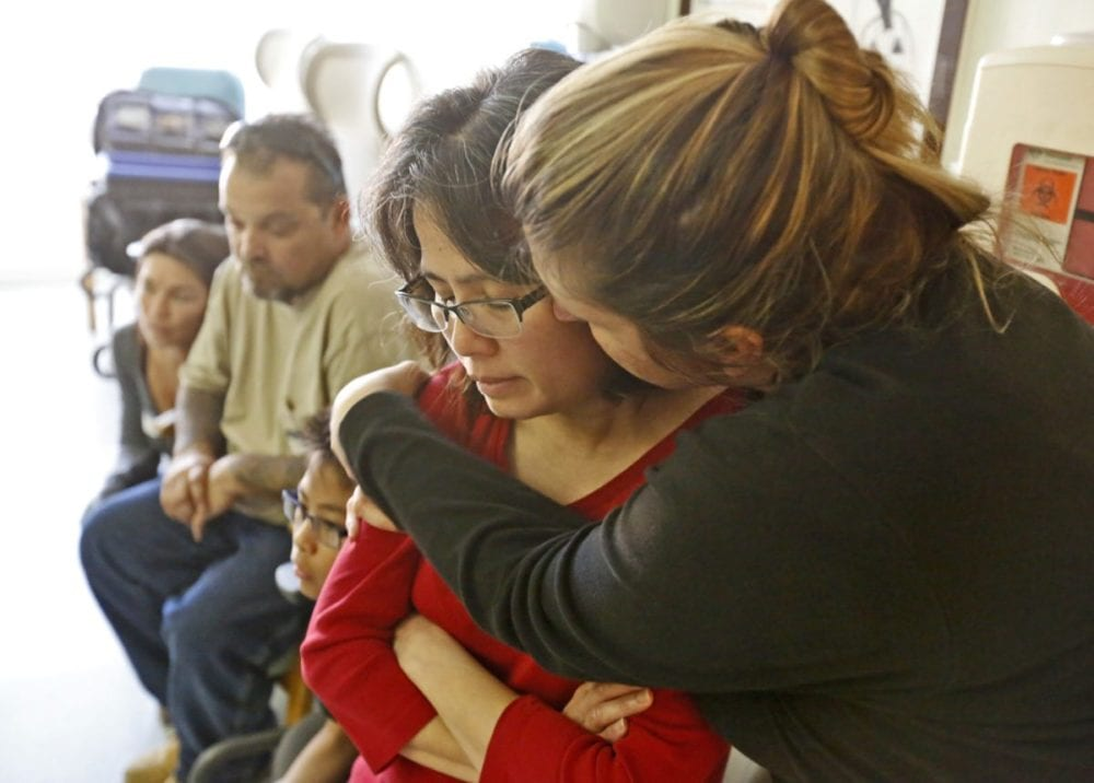 Joanna Klima, right, hugs Maritez Lopez, left, as they listen to Lopez's son, Tyler, 16, talk about the crash that almost killed him and friend Nicholas Klima, also 16, on Saturday. Katharine Lotze/Signal
