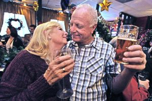 Carly and Bob Cookson of Newhall toast and kiss as they ring in the new year at the Rose and Crown British Restaurant in Newhall on Saturday. Dan Watson/The Signal