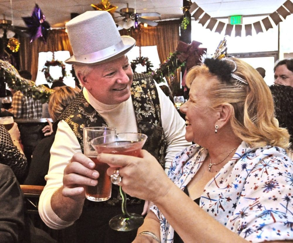 Sean and Susan O'Connell toast as they wait for the new year at the Rose and Crown British Restaurant in Newhall on Saturday. Dan Watson/The Signal