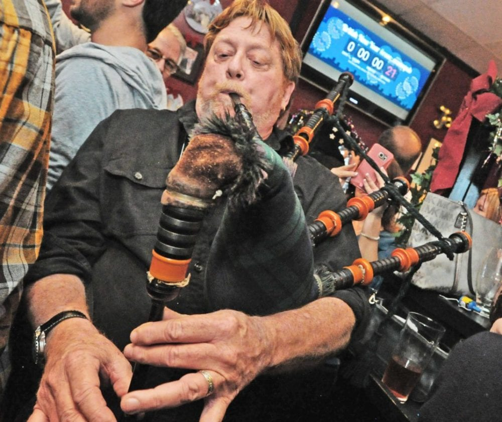 Walt Gorey plays Auld Lang Syne on his bagpipes for the crowd as they welcome in the new year, London England time - 4PM Santa Clarita time, at the Rose and Crown British Restaurant in Newhall on Saturday. Dan Watson/The Signal