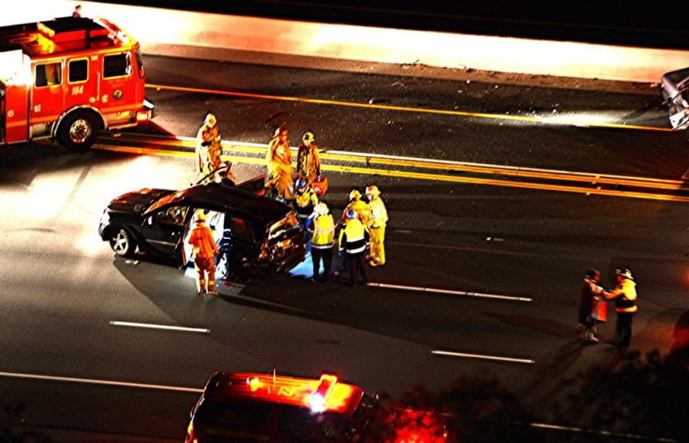 A stalled vehicle in the carpool lane of Highway 14 caused a multi-vehicle collision and six minor injuries Thursday night, according to officials. Photo by Rick McClure, for the Signal