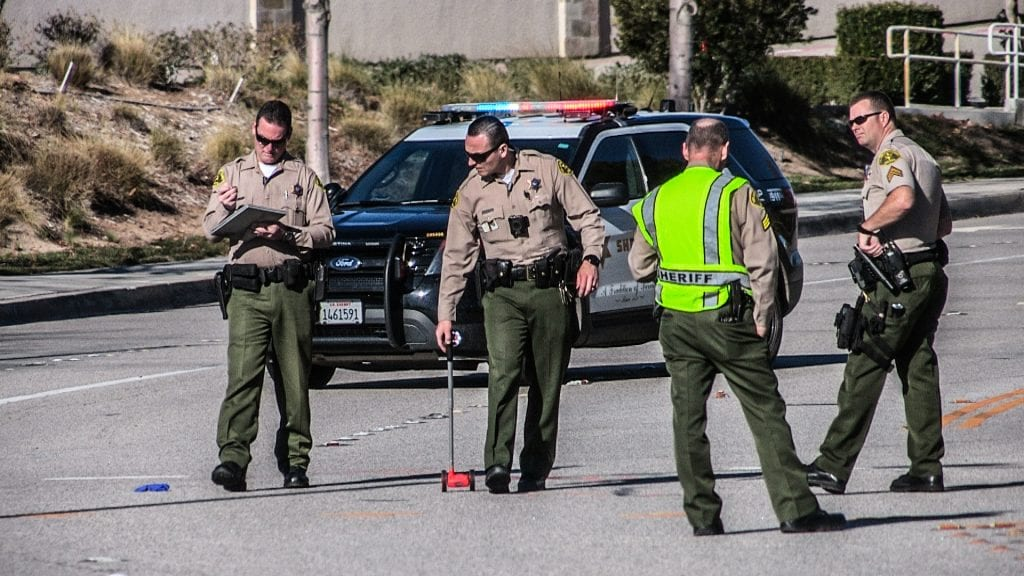 Traffic investigators from the Santa Clarita Valley Sheriff's Station probe a fatal crash on Kelly Johnson Parkway in Valencia Thursday morning. Austin Dave/The Signal