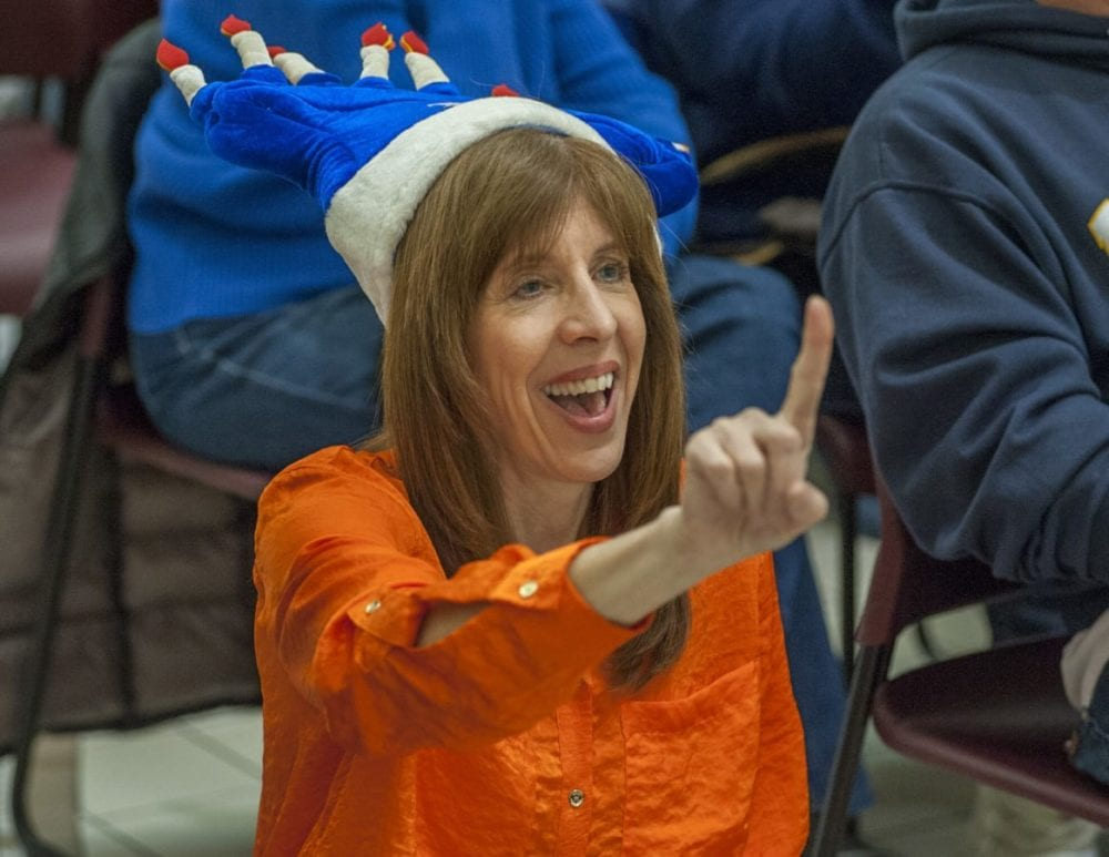 Conductor Wendy Hersh wears a festive menorah hat as she directs the Chabad of Santa Clarita Valley during a Chanukah celebration at the Westfield Town Center. Photo Tom Cruze/For the Signal
