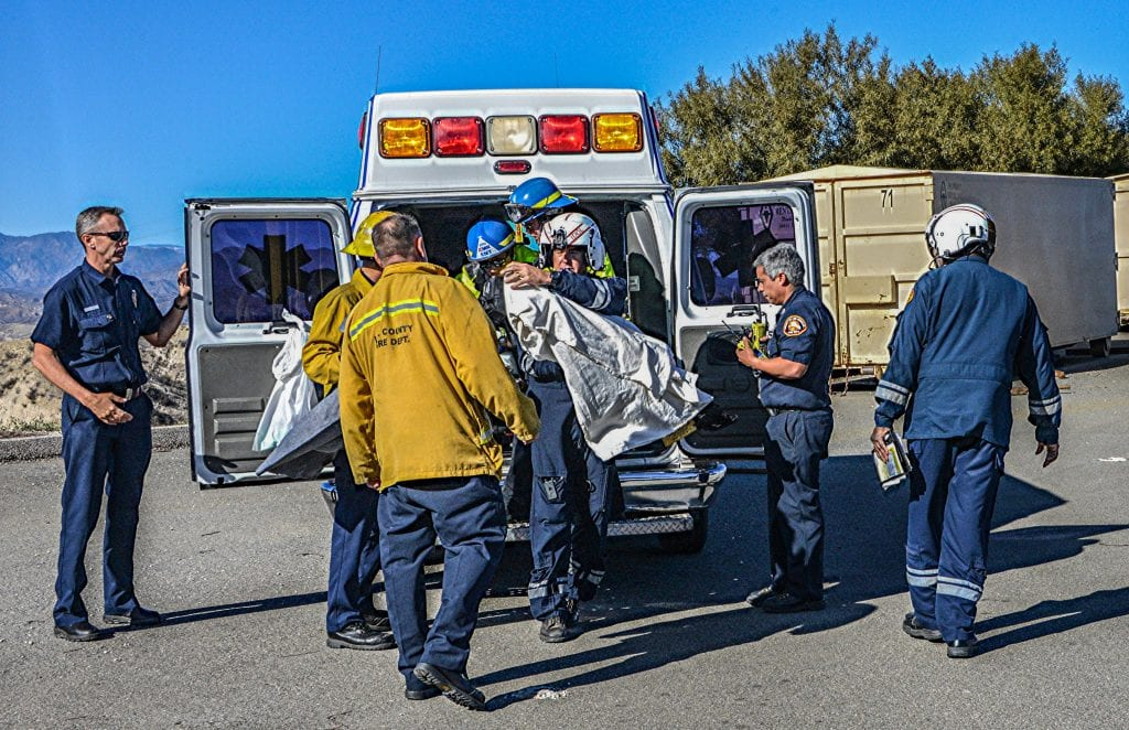 A child is removed from an American Medical Response ambulance and loaded into a county fire helicopter. The 18-month-old infant had fallen into a pool in Stevenson Ranch. Rick McClure/For The Signal