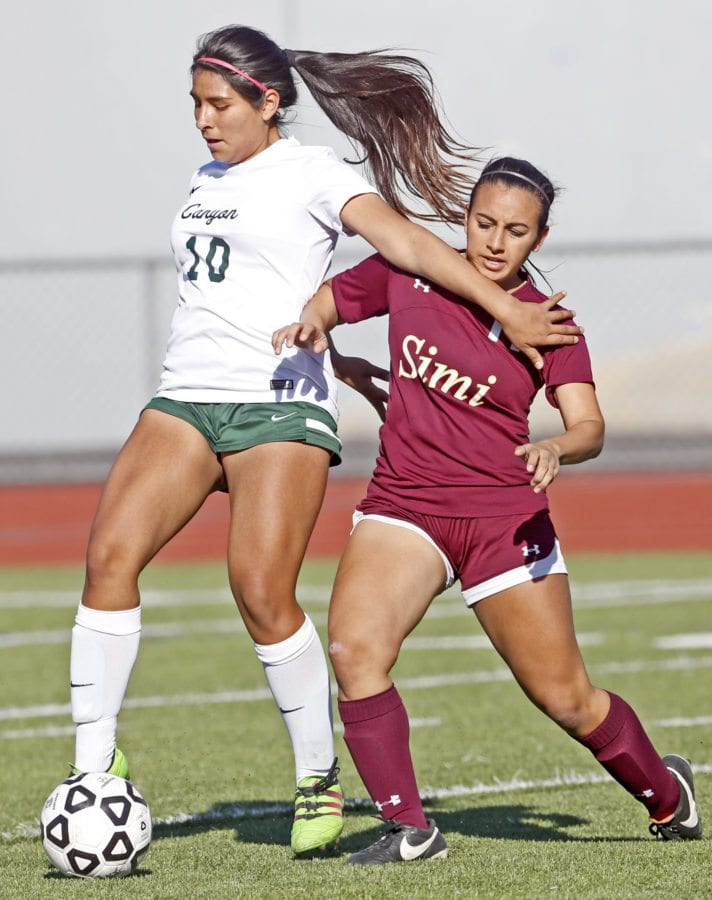 Canyon's Emeely Valdez (15) tries to keep the ball away from Simi Valley's Janelle Effarah (11) Wednesday at Canyon High School. Katharine Lotze/Signal