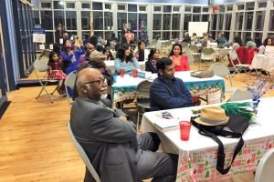 Guests enjoying the speaker at the International Friendship Center's annual holiday event. Courtesy photo
