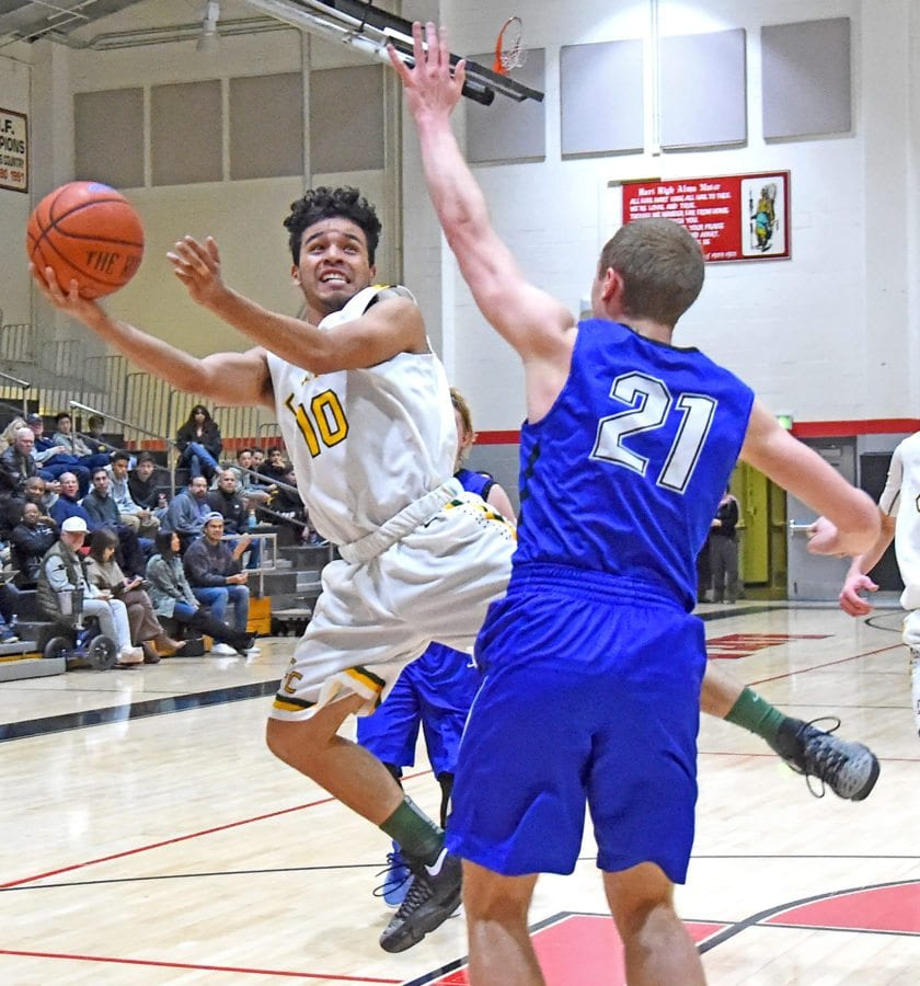 Palmer's Liam Hughes-Duffy (21) defends Canyon's Josue Valencia as Valencia tries to beat the shot clock in the second half at Hart High. Photo by Jayne Kamin-Oncea/For The Signal