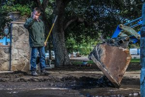 People work to clear a mudslide from the Sand Fire burn area Saturday afternoon. Austin Dave/The Signal