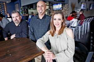 Iggy Trujillo, Miguel Perez, and Martha Trujillo at their new restaurant, MJ's Tap House Grill.