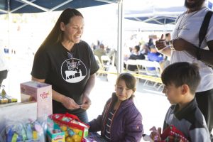 Ellie Laks, co-founder of The Gentle Barn, speaks with children at the sixth annual toy donation drive with Los Angeles Police Department's Southeast Division. Photo by Michelle Shiers, courtesy of The Gentle Barn