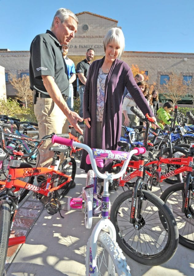 Steve Cassulo, District Manager, Chiquita Canyon, left, and Joan Aschoff, President and CEO, Child & Family Center discuss the 39 bicycles donated by Chiquita Canyon to the Child & Family Center in Santa Clarita on Tuesday. Dan Watson/The Signal