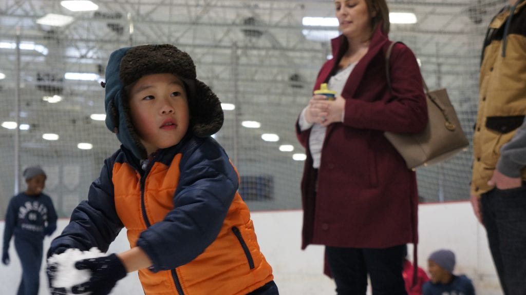 Isaac Kim, 5, prepares to launch a snowball towards his father at the Valencia Ice Station Family Snow Day on Sunday. Samie Gebers/ The Signal