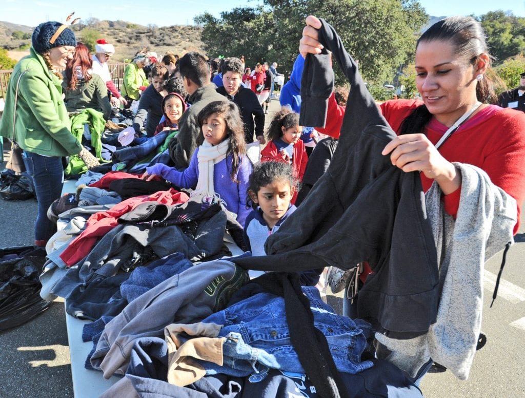 Hundreds of attendees sort through donated clothing at the Festividad for Christ community event held at Faith Community Church in Newhall on Saturday. Dan Watson/The Signal