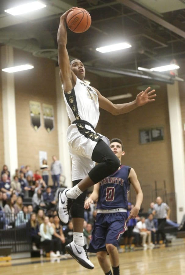 Golden Valley's Brandon Wilson (33) goes in for a dunk during a basketball game against Trinity on Friday. Katharine Lotze/Signal
