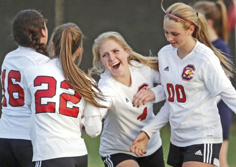 SCCS' Cassidy Oliver (4) celebrate teammate Jennifer Curry's (22) goal against St. Monica's Academy during a soccer game at the Master's University on Friday. Katharine Lotze/Signal